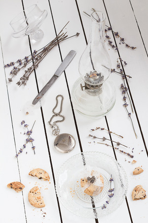 wooden lid: Small Cookie Gift on a Crystal Plate with Dried Lavender, a Vintage Oil Lamp and a Pocket Watch