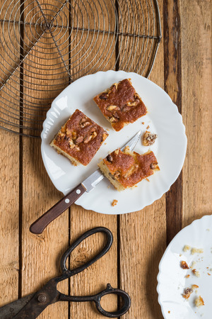 walnut cake: Homemade Walnut Cake on a Rustic Wood Table. Overhead View Stock Photo