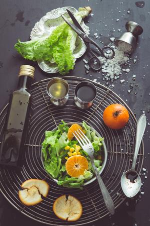 Retro Filtered Image: Lettuce Salad with Mandarin Oranges, Sweet Corn and Basic Dressing Ingredients photo