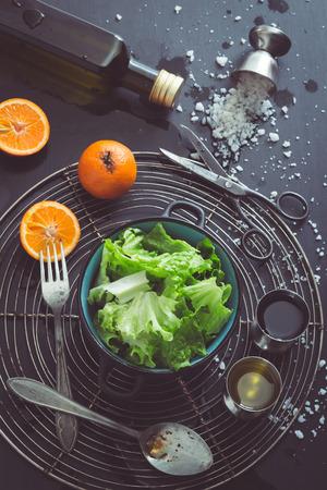 Retro Filtered Image: Lettuce Salad with Mandarin Oranges and Basic Dressing Ingredients photo