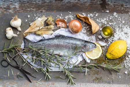 Roast Rainbow Trout Ingredients Still Life. Vintage Metal Background. Overhead View photo