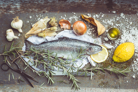 Retro Filtered Image: Roast Rainbow Trout Ingredients Still Life. Vintage Metal Background. Overhead View photo