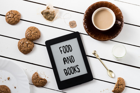 Eating and EReading. Flourless Walnut Cookies and Black Tea with Milk. FOOD AND BOOKS Text Included photo