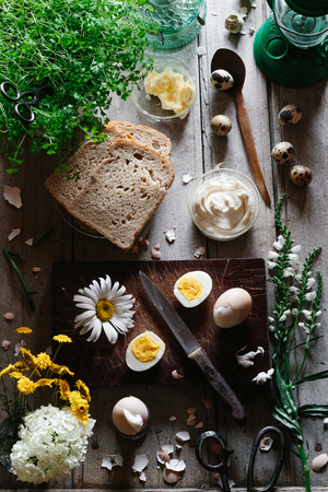 Preparing a cold sandwich with egg, mayonnaise and watercress for breakfast, brunch or lunch
