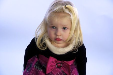 Beautiful little girl in holiday dress. photo