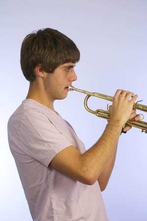 handsom: Handsom young man Playing trumpet.