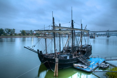 Replicas of 15th Century Ships docked in a modern city park. Old meets new photo