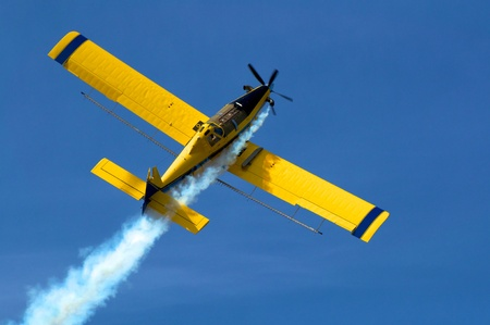 Crop duster at work applying chemicals to field Stock Photo - 13504805