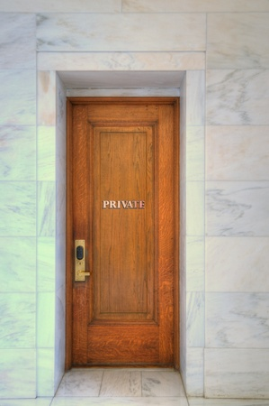 Closed Oak Door Surrounded by marble  Keep out, Privacy  Stock Photo