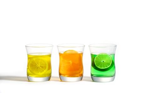 Refreshing Tri-color fruit drinks, Lemon, Lime, and Orange. Stock Photo - 13959803
