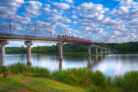 Early Morning Twin Rivers Pedestrian Bridge with Puffy White Clouds Over The Arkansas River  Stock Photo