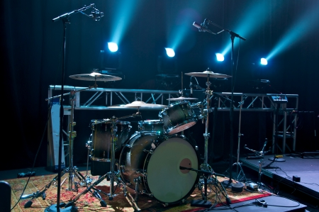 blues: Drum Kit on stage backlit with stage lighting. Stock Photo