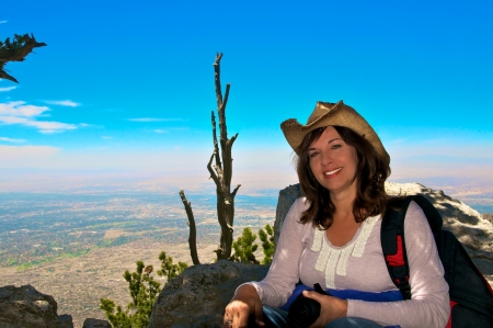 Beautiful woman sitting on mountain western US top  photo