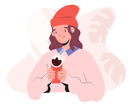 Hipster girl drinking coffee to go, holding a hot cup of coffee warming her hands , young women in stylish trendy outfit, wearing beanie hat and oversize sweater, flat vector illustration  イラスト・ベクター素材