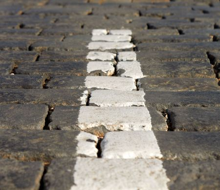 Close-Up of White Stripe On Red Square Block Pavement photo