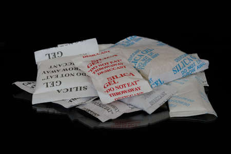 Different kinds of sachets of silica gel used used to attract moisture in packaging