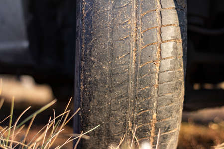 A worn out car tire. Danger of using tires with worn out tread.