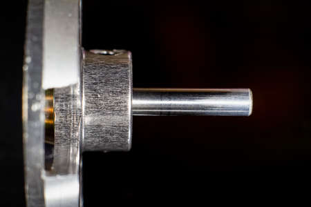 Brushless (BLDC) outrunner motor shaft for aircraft model close-up on a black background. Copyspace. Selective soft focus.