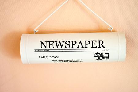 fake newspaper: The white Newspaper Tube at the Wall Stock Photo