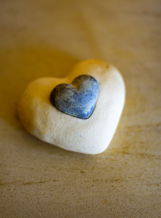 litle: The white Stone Heart with a litle Heart in the middle Stock Photo