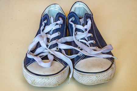 shoelaces: A few blue sneakers with white laces