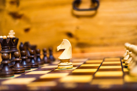 The horse is attacking the pawn in chess Stock Photo