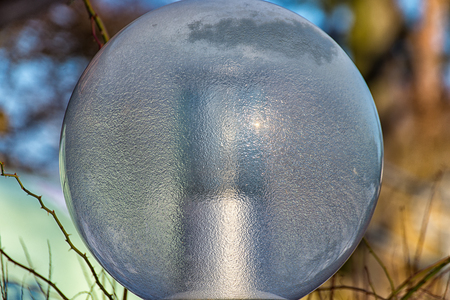Street lamp glass half frozen in the winter