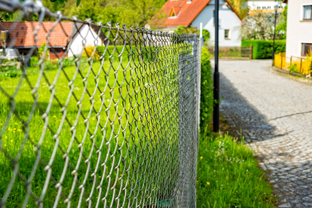 metal net: The Wire netting fence as a delimitation of the property Stock Photo