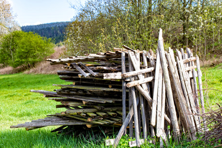 The very Old wood on a stack on thr meddow Stock Photo