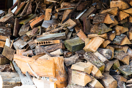 inflammable: Much Plenty of firewood for the fireplace in a pile