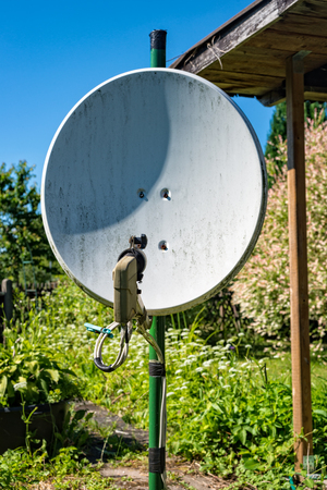 A Old satellite dish standing in a garden in Tuhringia Stock Photo