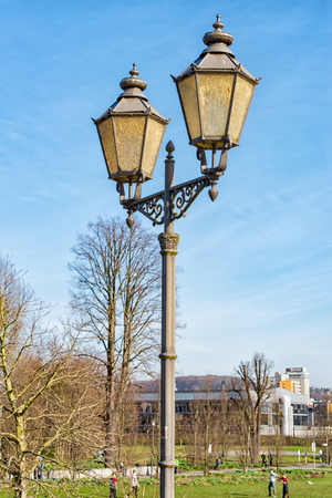 A Old street lamp made of green metal Stock Photo