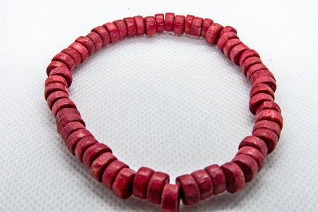Bangle made of red wooden beads