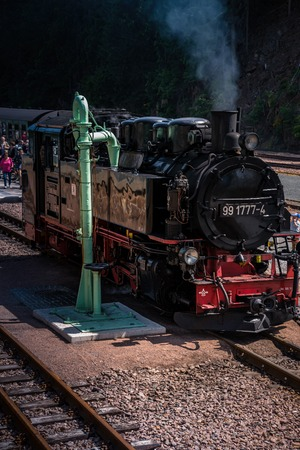 Old locomotive with coal stove Editorial