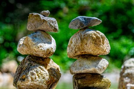 Stacked stones next to a mountain lake Stock fotó