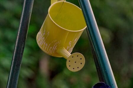 Yellow watering can made of metal Stockfoto