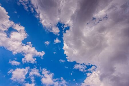 Blue sky with white summer clouds