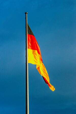 Germany flag black red gold blowing on the flagpole
