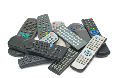 A lot of remote control devices  Isolated on white background  Stock Photo