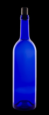 Wine in blue bottle  Isolated on black background  Stock Photo