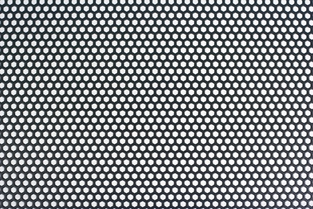Abstract background texture   Grille made of perforated sheet metal   Stock Photo