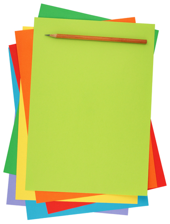 colored paper and pencil isolated on white background