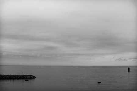 Minimalist landscape of the quiet beach of Gijón, Asturias, Spain.The photo is in black and white and aims to convey tranquility and calm.