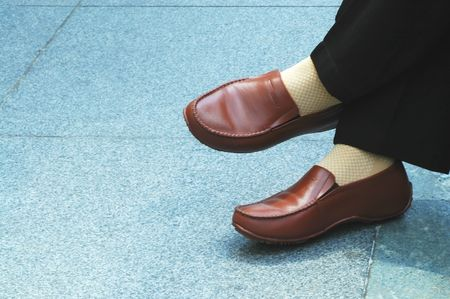 slack: Cross legged legs with brown shoes