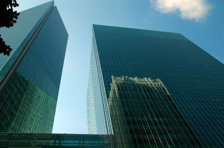 Two skyscapers with blue sky as the background