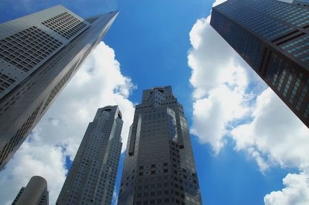 Skyscrapers and high rise buildings against a blue sky and white clouds