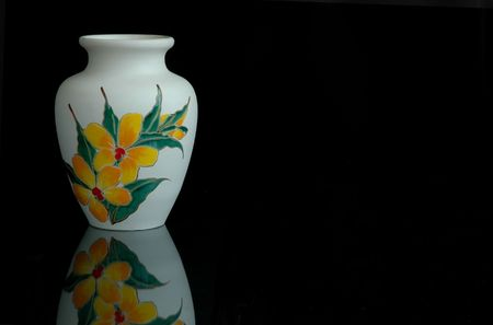 A white pottery vase of Malaysian origin with its reflection Stock Photo