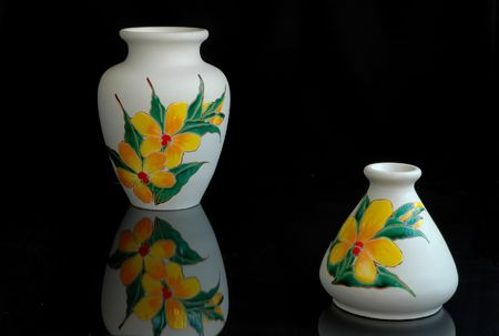 Two white pottery vases of Malaysian origin with orchid motifs Stock Photo