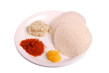 Idli with chutney, ghee and chutney powder Stock Photo - 9738331
