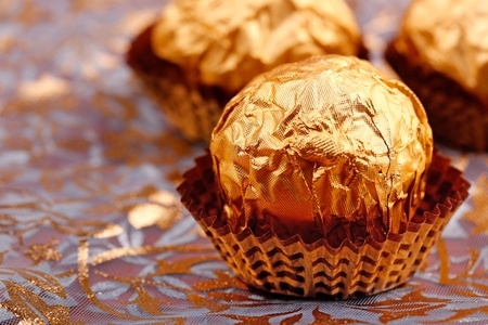 ferrero: Closeup of chocolate wrapped in golden foil